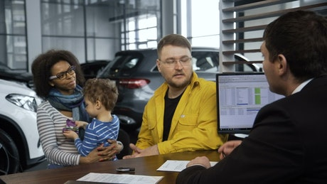 A young family buying a new car