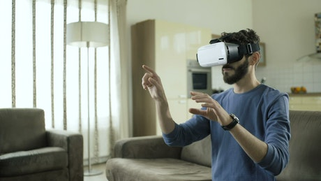 A young man working with VR glasses