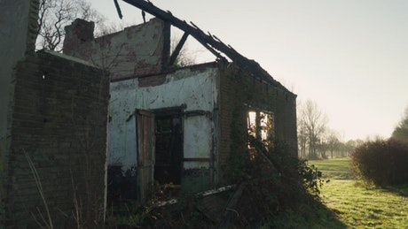 Abandoned and run down house in a beautiful meadow