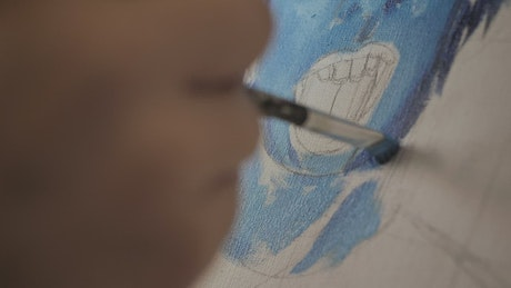 Abstract face of blue color being painted