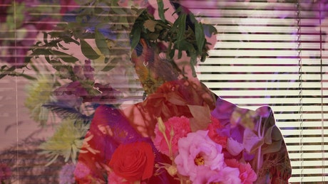 Abstract female video with an LGBTQ boy and flowers