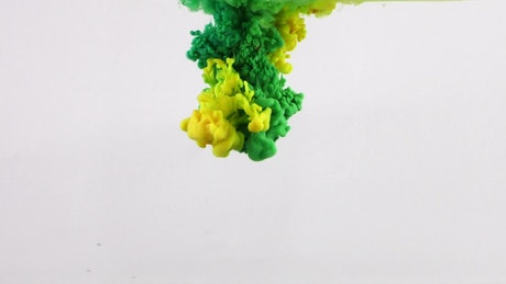 Abstract green and yellow ink shots underwater