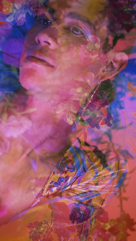 Abstract LGBTQ video of a boy appreciating flowers