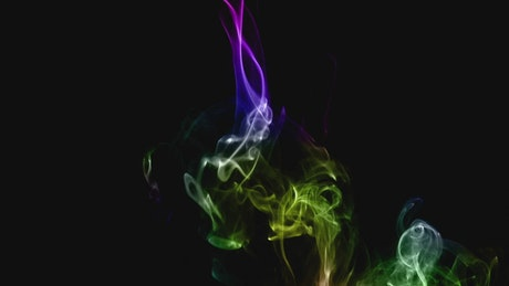 Abstract multicolored smoke on dark background