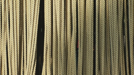 Abstract video of a man holding ropes