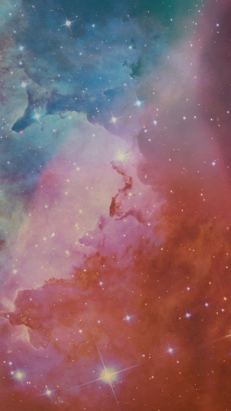 Abstract video of space covered by a nebula and stars
