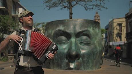Accordionist playing a song in the street