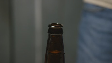 Adding and sealing a beer cap to the bottle