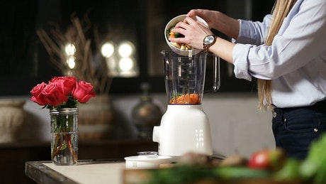 Adding chopped food to a blender