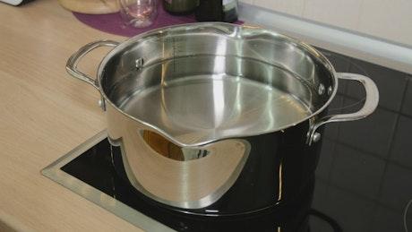 Adding cut mushrooms to a pan