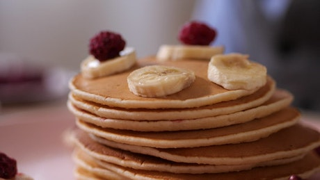 Adding fruit to breakfast pancakes