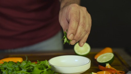 Adding herbs to a bowl