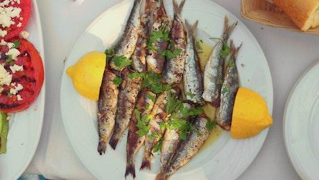 Adding lemon to a fish dish