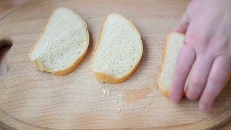 Adding oil to bread slices