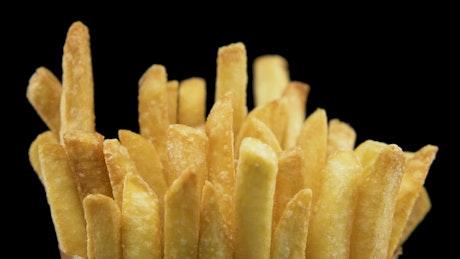 Adding salt to fast food fries