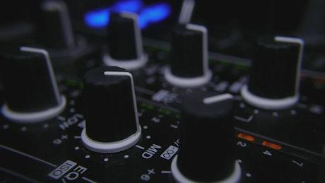 Adjusting knobs in mixer controller