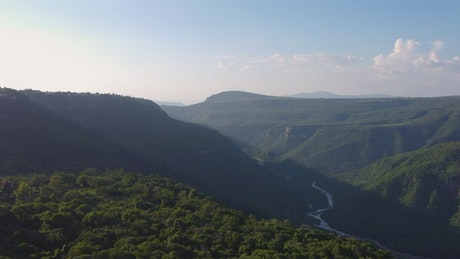 Aerial landscape over a vegetation covered canyon