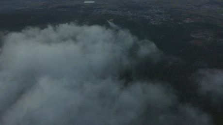 Aerial panorama of a natural relief covered by clouds