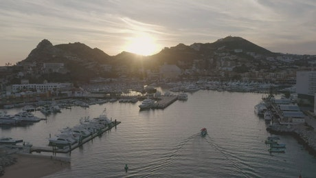Aerial panorama of a tourist port at sunset