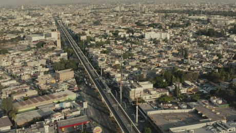 Aerial panorama of a train crossing a big city