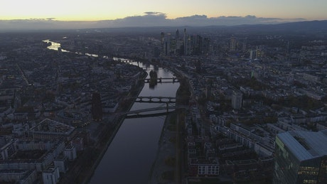 Aerial panoramic view of a river across the city