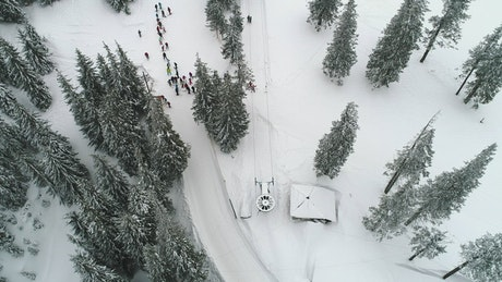 Aerial shot of a ski station with people practicing