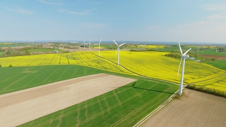 Aerial shot of a wind farm, slow motion