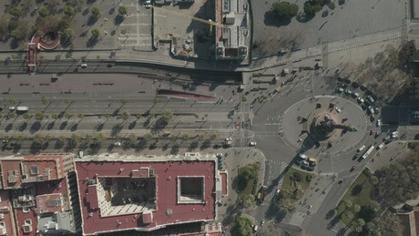 Aerial shot of an avenue and roundabout in Barcelona