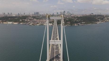 Aerial shot of traffic on a suspension bridge