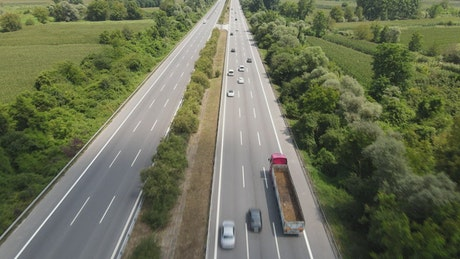 Aerial tacking shot of the highway traffic
