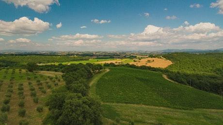 Aerial timelapse flyover farmland countryside