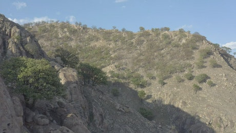Aerial tour between the arid hills of a mountain range