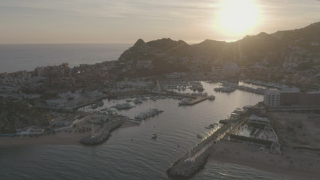 Aerial tour of a port at sunset