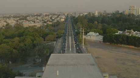Aerial tour over the train tracks that cross a city