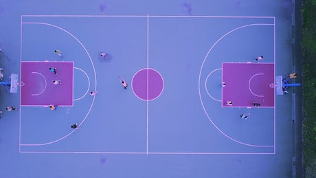 Aerial view of a blue and purple basketball court