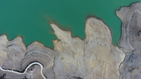 Aerial view of a blue lake and mountains