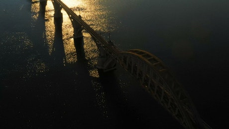 Aerial view of a bridge and the city in the sunset