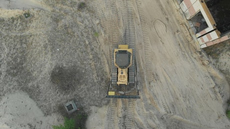 Aerial view of a bulldozer on a dirt field