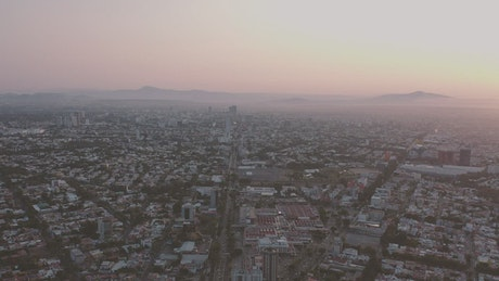 Aerial view of a city during the sunrise