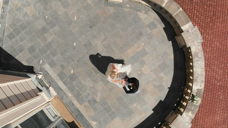 Aerial view of a couple dancing at a wedding