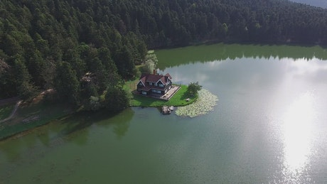 Aerial view of a house by the lake