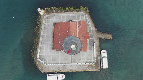 Aerial view of a lighthouse on a small island