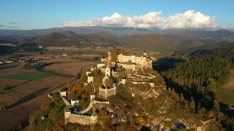 Aerial view of a medieval castle in the mountain