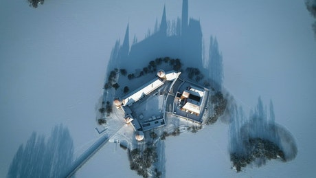 Aerial view of a medieval castle in the winter