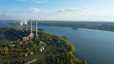 Aerial view of a power plant near the river