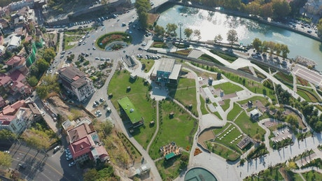 Aerial view of a roundabout, a bridge, and a river