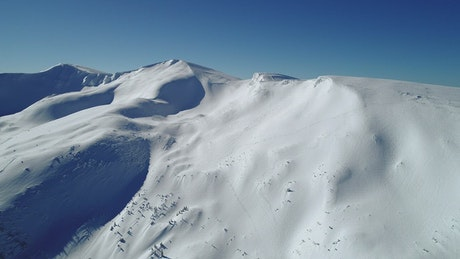 Aerial view of a snow-covered mountain, landscape