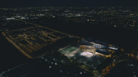 Aerial view of a sports center at night time