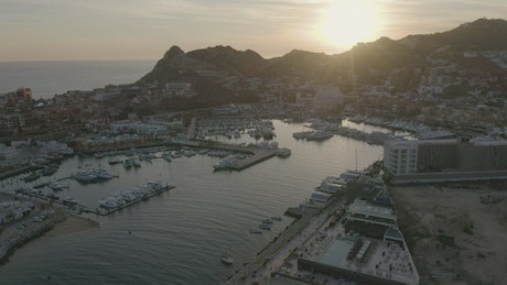 Aerial view of a tourist port during sunset