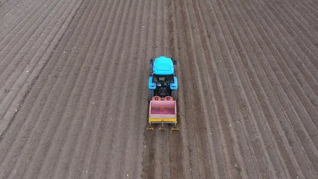 Aerial view of a tractor preparing the soil
